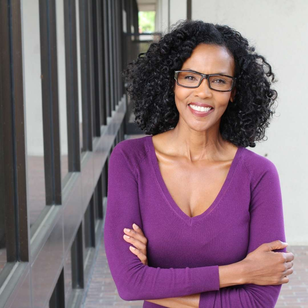 Successful african-american woman who is skilled at getting high-paying clients. Attract Clients Online. Pamela Bruner.