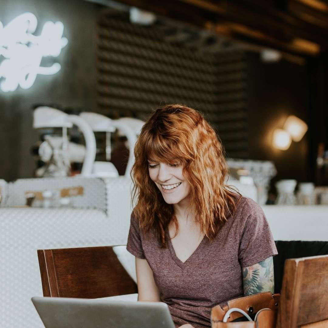 Woman at computer building a client-attracting website. Attract Clients Online. Pamela Bruner.