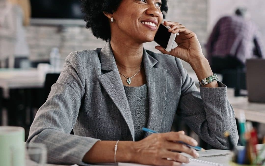 Woman working on selling her high-ticket coaching offer.